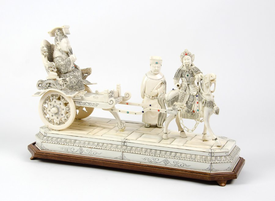A CHINESE CARVED IVORY FIGURAL GROUP