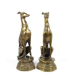 A PAIR OF GILT METAL MODELS OF GREYHOUNDS