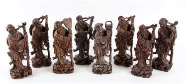 A GROUP OF EIGHT CHINESE STYLE CARVED HARDWOOD FIGURES