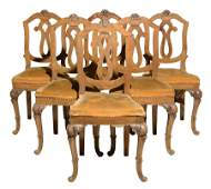A SET OF SIX PROVINCIAL STYLE SIDE CHAIRS