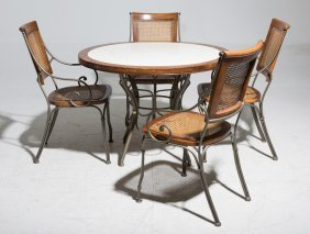 A Breakfast Table With Four Matched Chairs