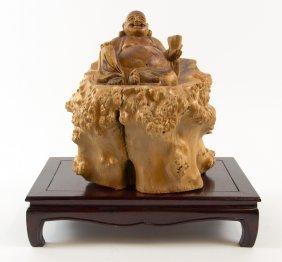 A Naturalistically Carved Wood Budai