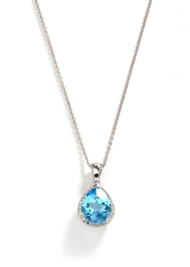 A BLUE TOPAZ AND DIAMOND PENDANT - 2