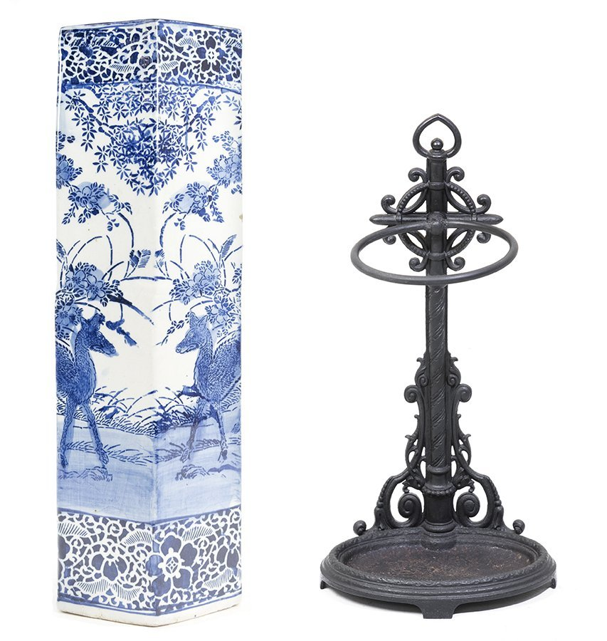 A METAL CANE STAND AND BLUE AND WHITE PORCELAIN