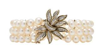 A THREE-STRAND CULTURED PEARL BRACELET WITH A 14K
