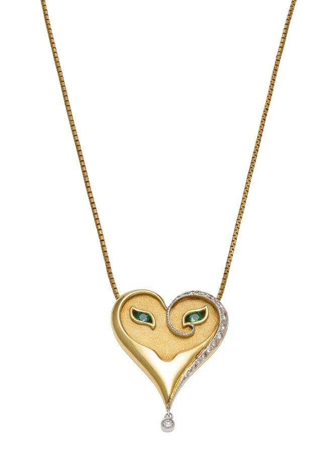 AN 18K YELLOW GOLD EMERALD AND DIAMOND HEART PENDANT BY