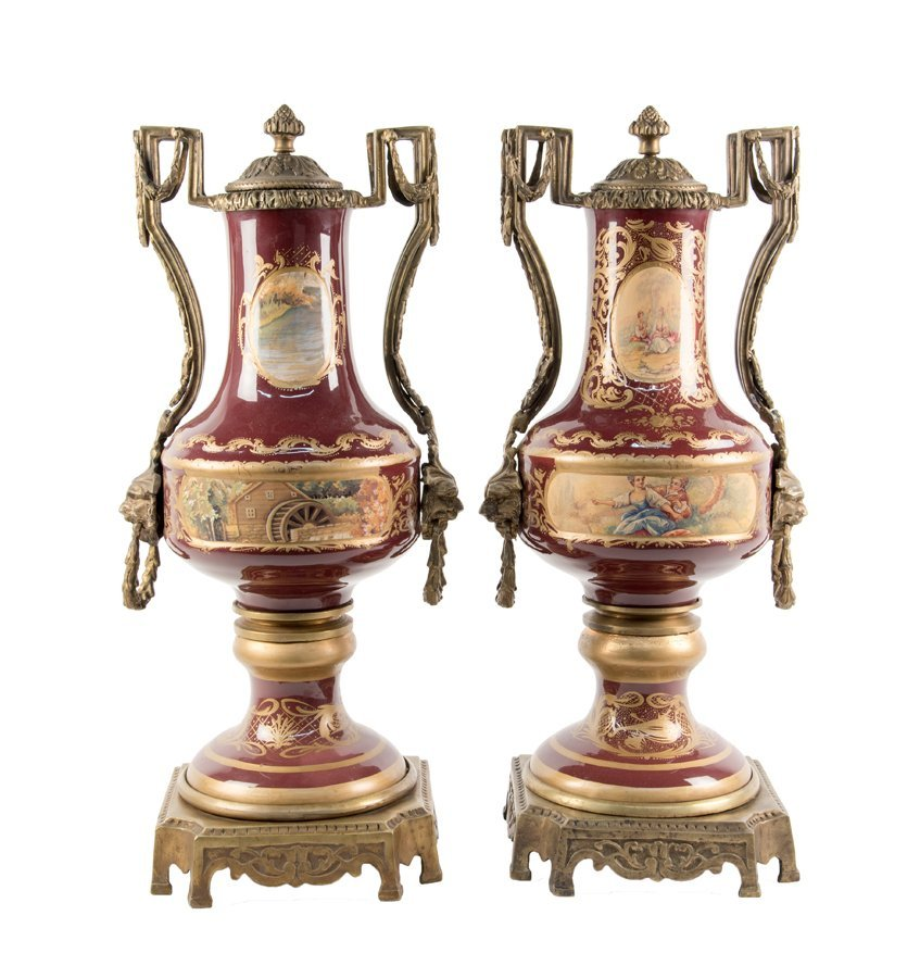 A PAIR OF CONTINENTAL STYLE ORMOLU MOUNTED PORCELAIN