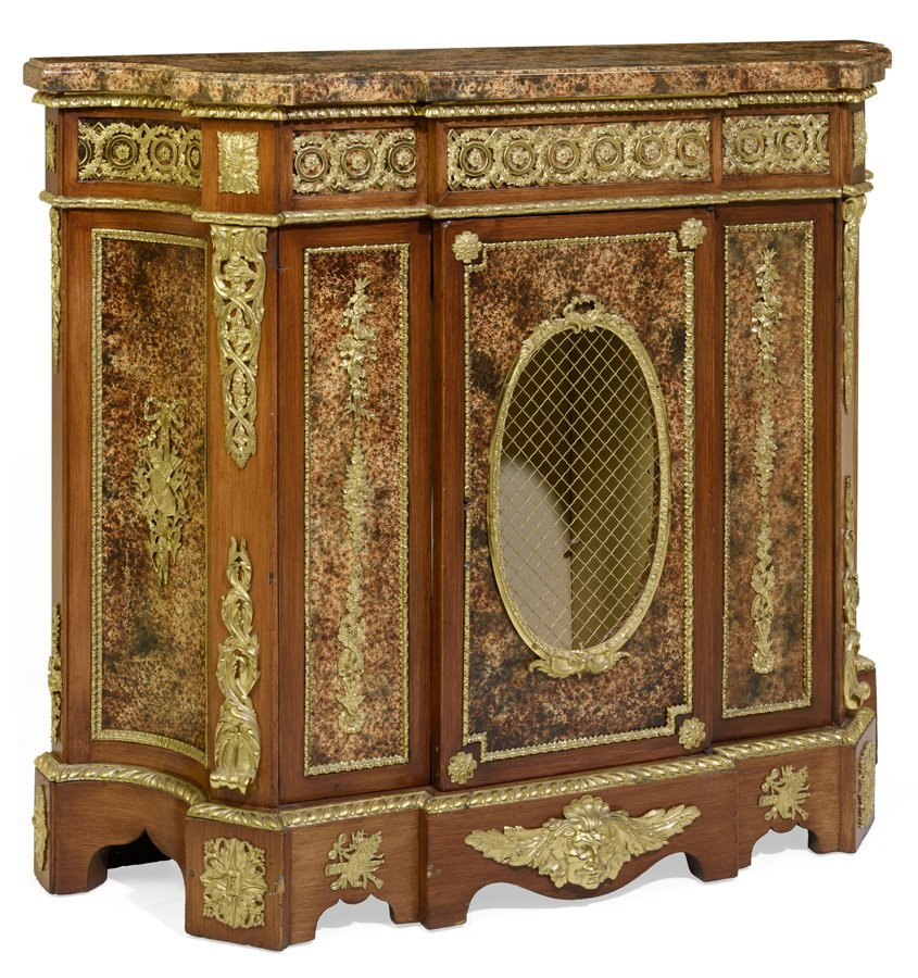 A FRENCH ORMOLU MOUNTED AND MAHOGANY VENEERED CABINET