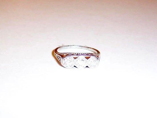 2: WHITE GOLD AND DIAMOND THREE STONE RING
