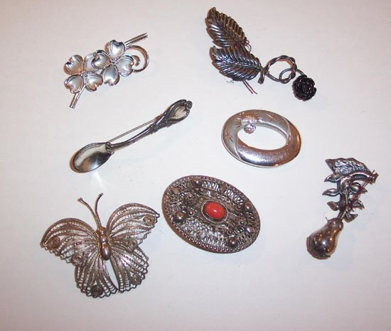 15: GROUP OF SEVEN STERLING SILVER LADY'S PIN