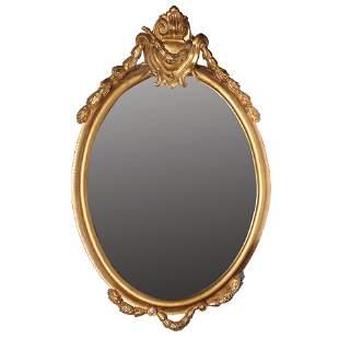 A Giltwood Oval Framed Mirror