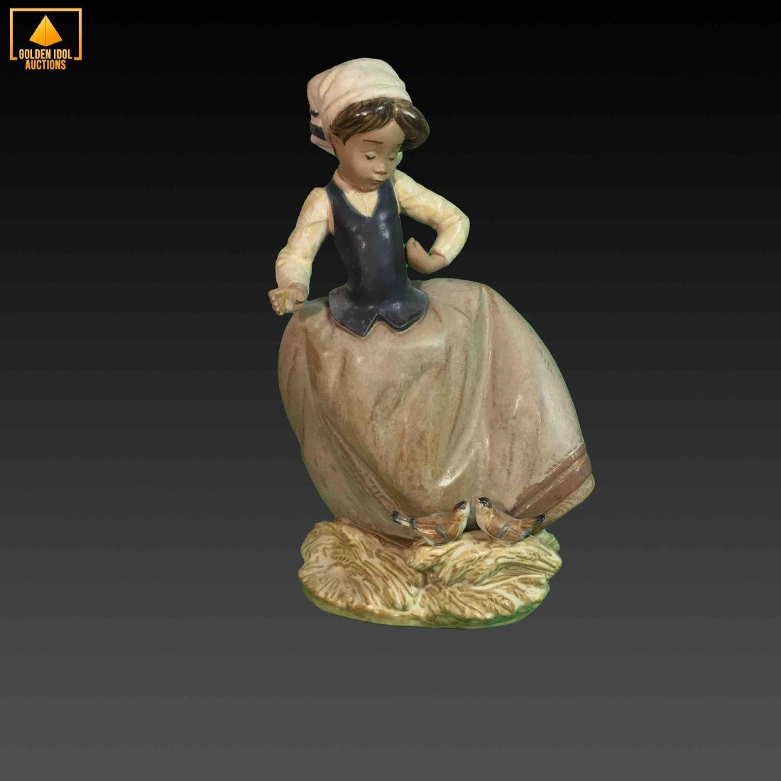 Old Lladro girl with pair of birds