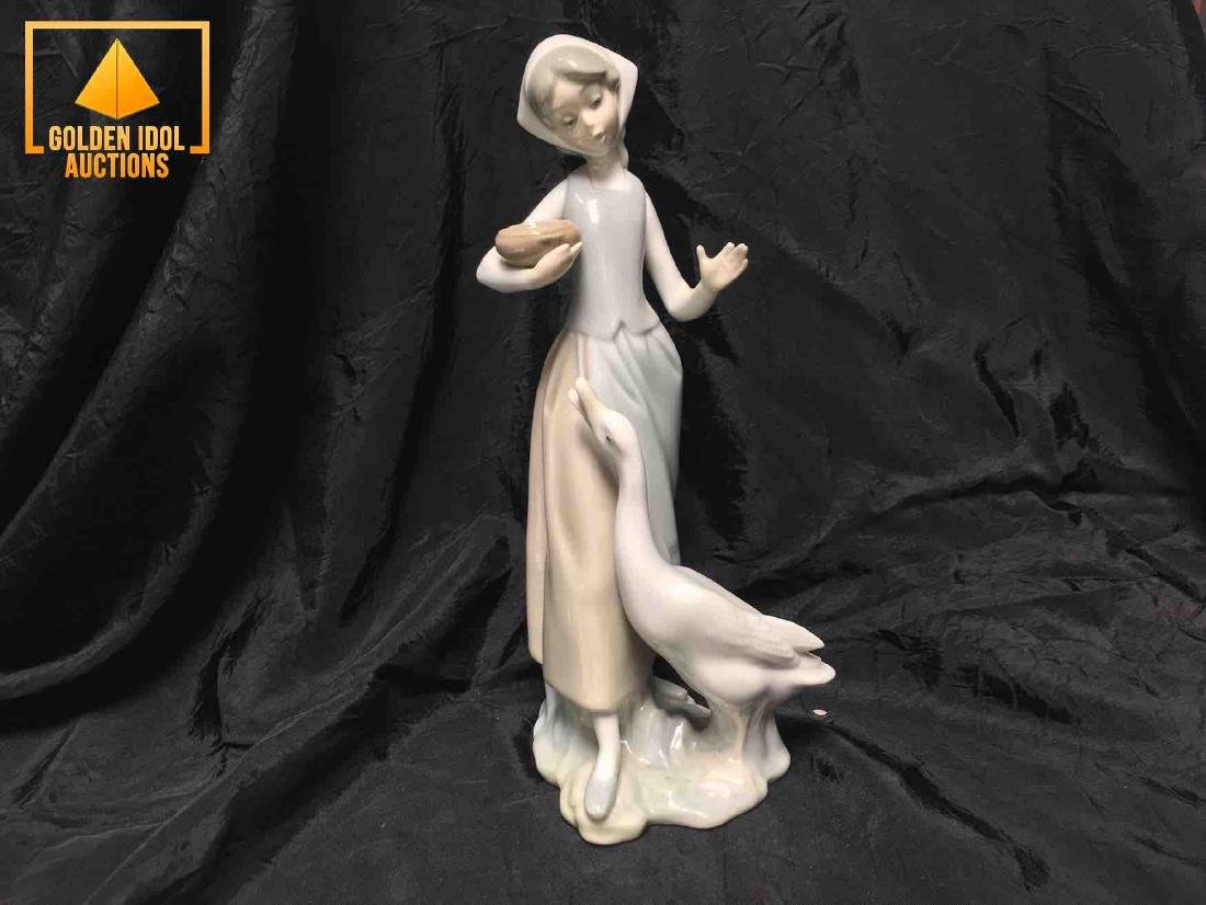 Lladro porcelain figurine of a shepherdess with a swan.