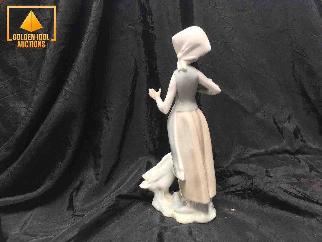 Lladro porcelain figurine of a shepherdess with a swan. - 2