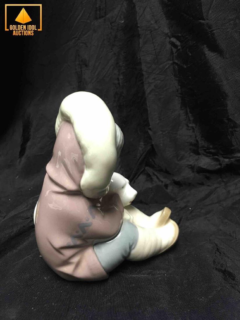 Lladro figurine of an Eskimo child embracing a bear. - 2