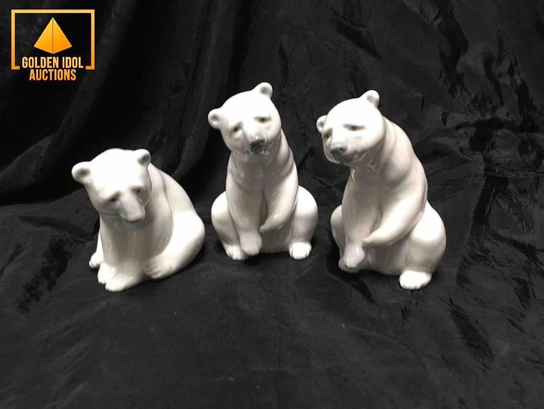 Lladro figurine of three polar bears.