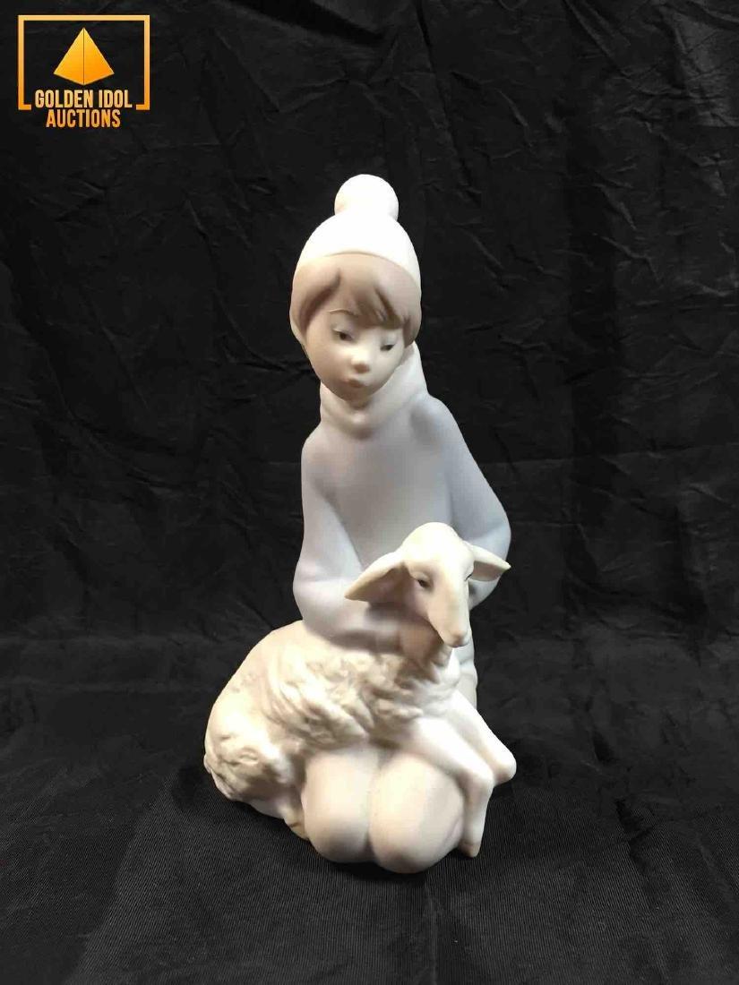 Lladro Figurine of a Shepherd boy with a sheep.