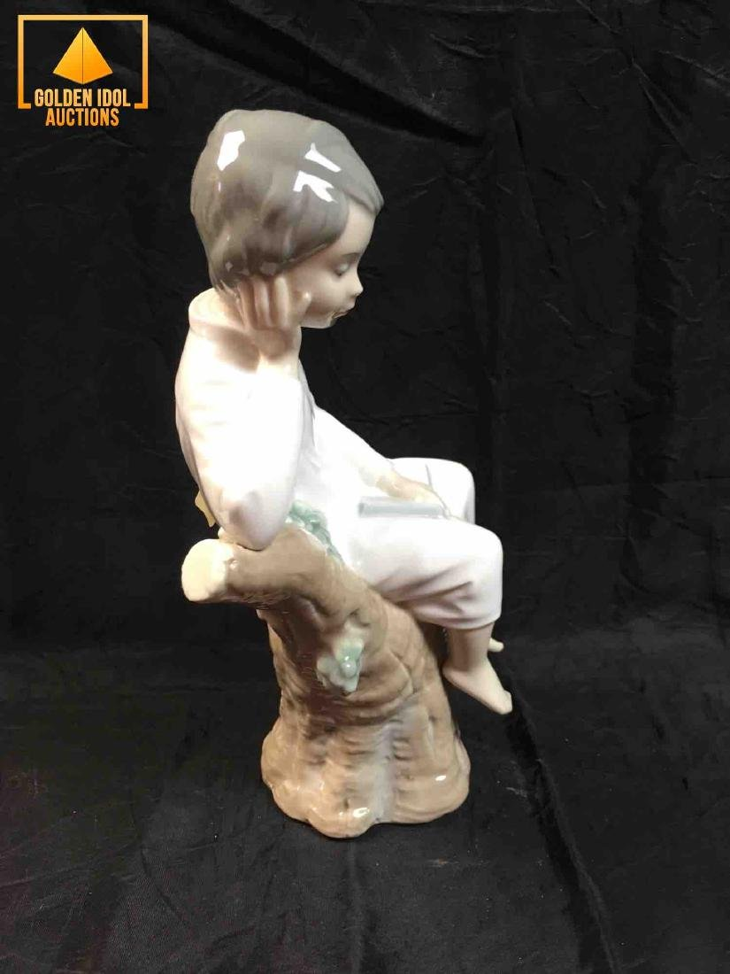 Lladro Porcelain figurine of a Child sitting on tree - 2