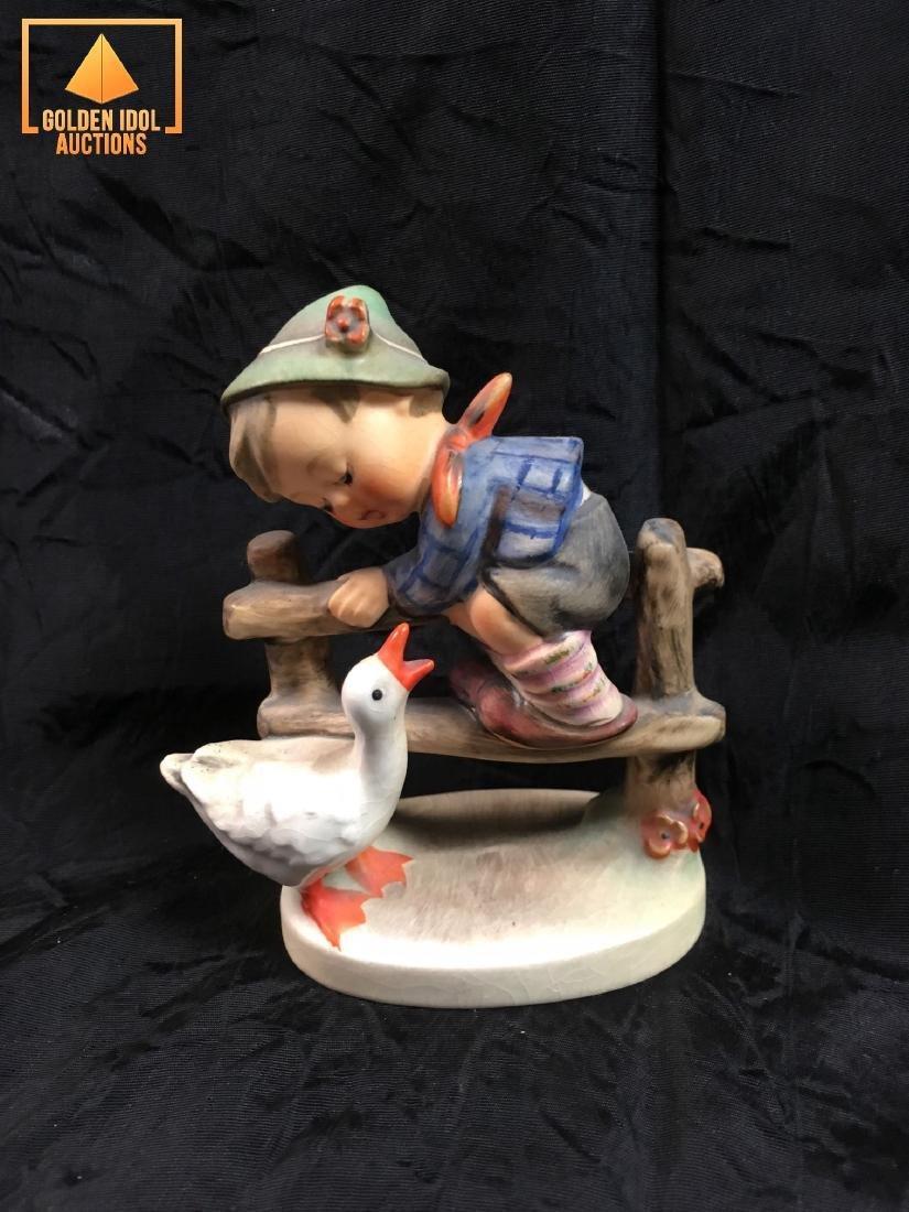 Hummel Figurine - Boy on fence with duck