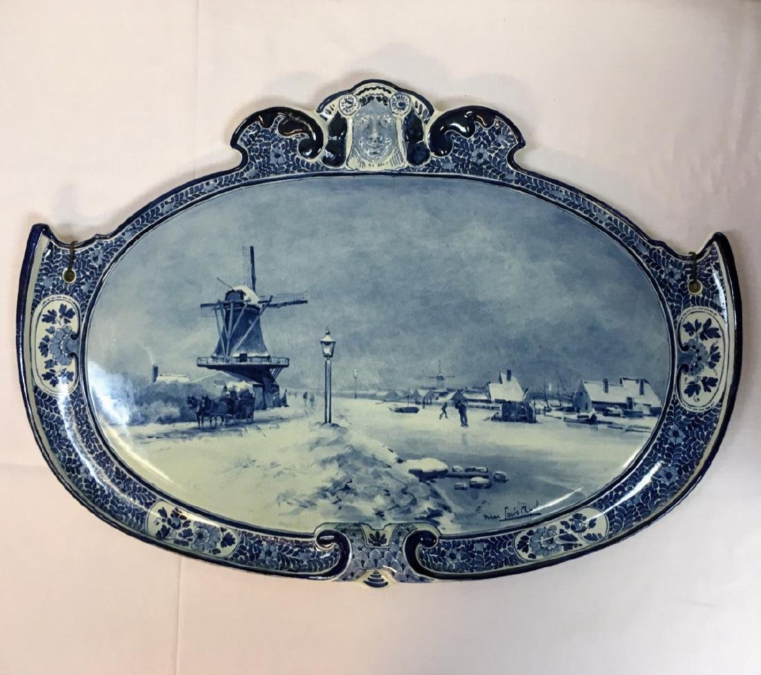 """19th Century Oval Delft wall plaque, signed """"Louis"""