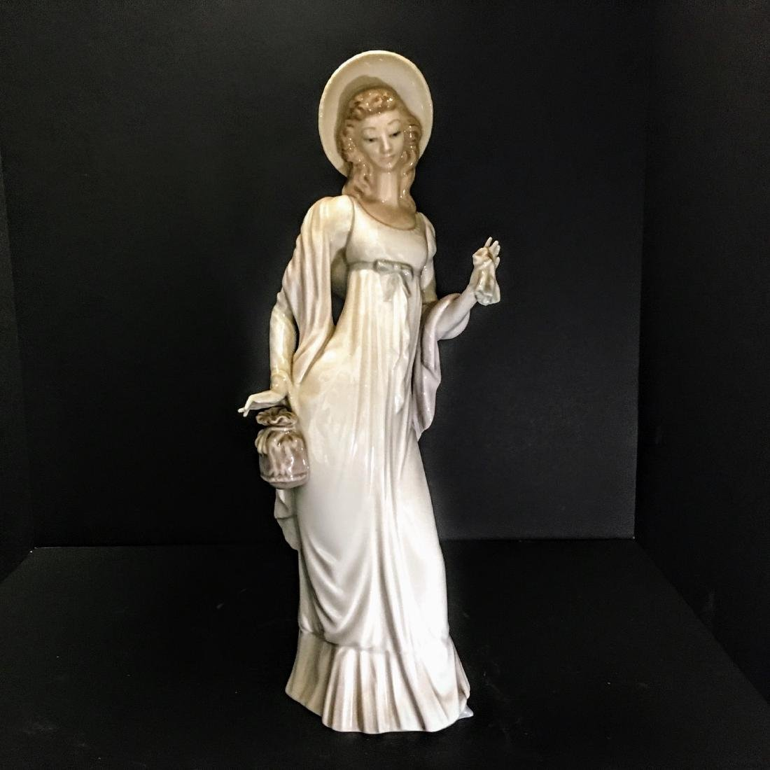 Lladro Figurine - Girl with hat and purse.