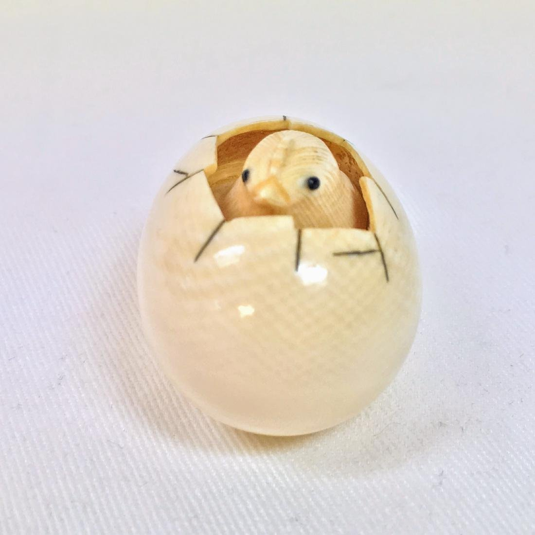 A carved Netsuke figure of a small chick cracking his - 7
