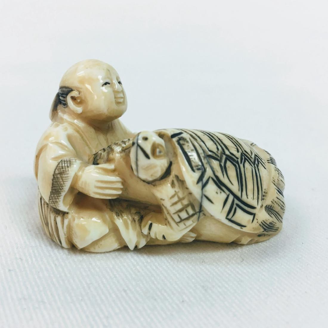 19th Century Netsuke man with turtle figure