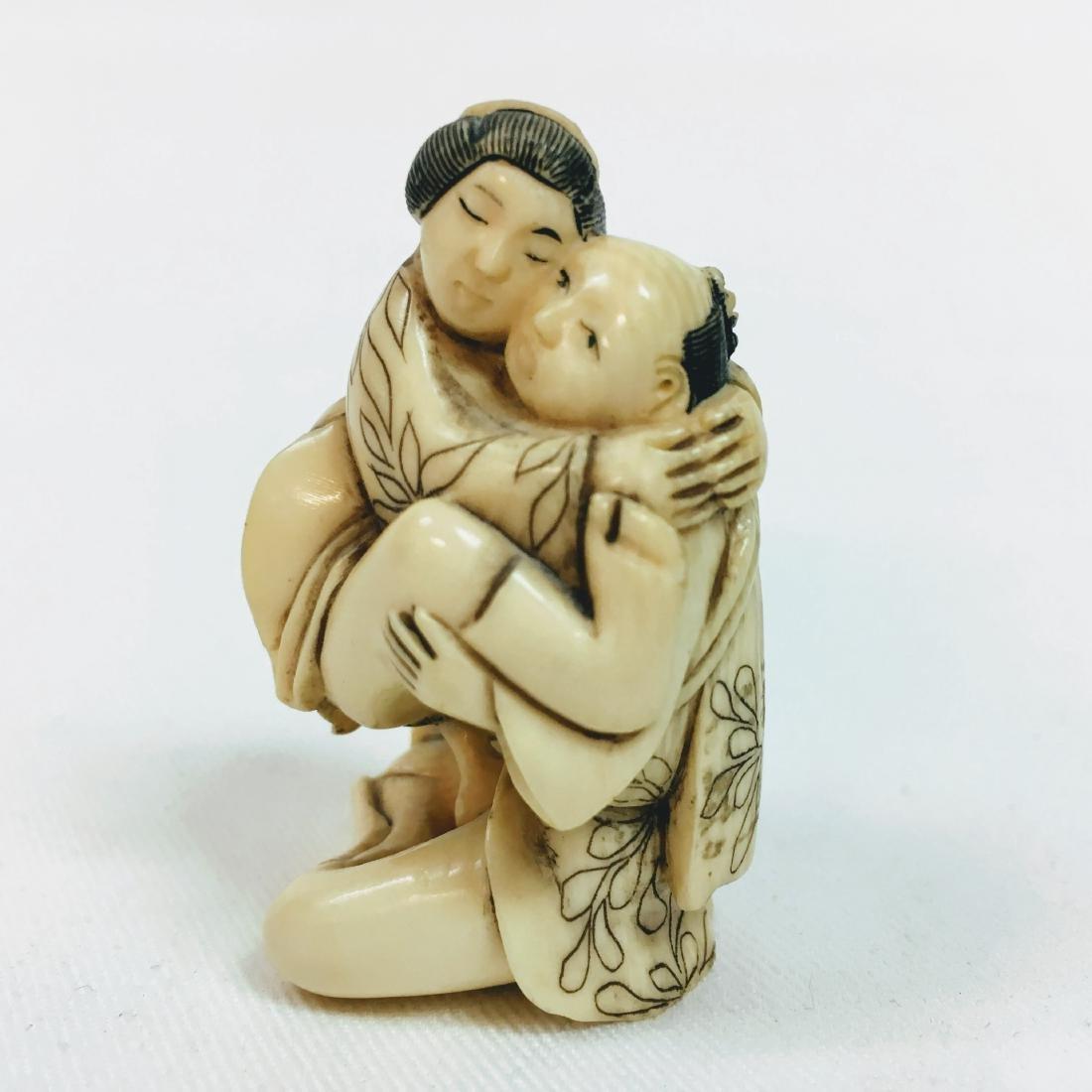 19th Century Erotic Netsuke man with woman figure