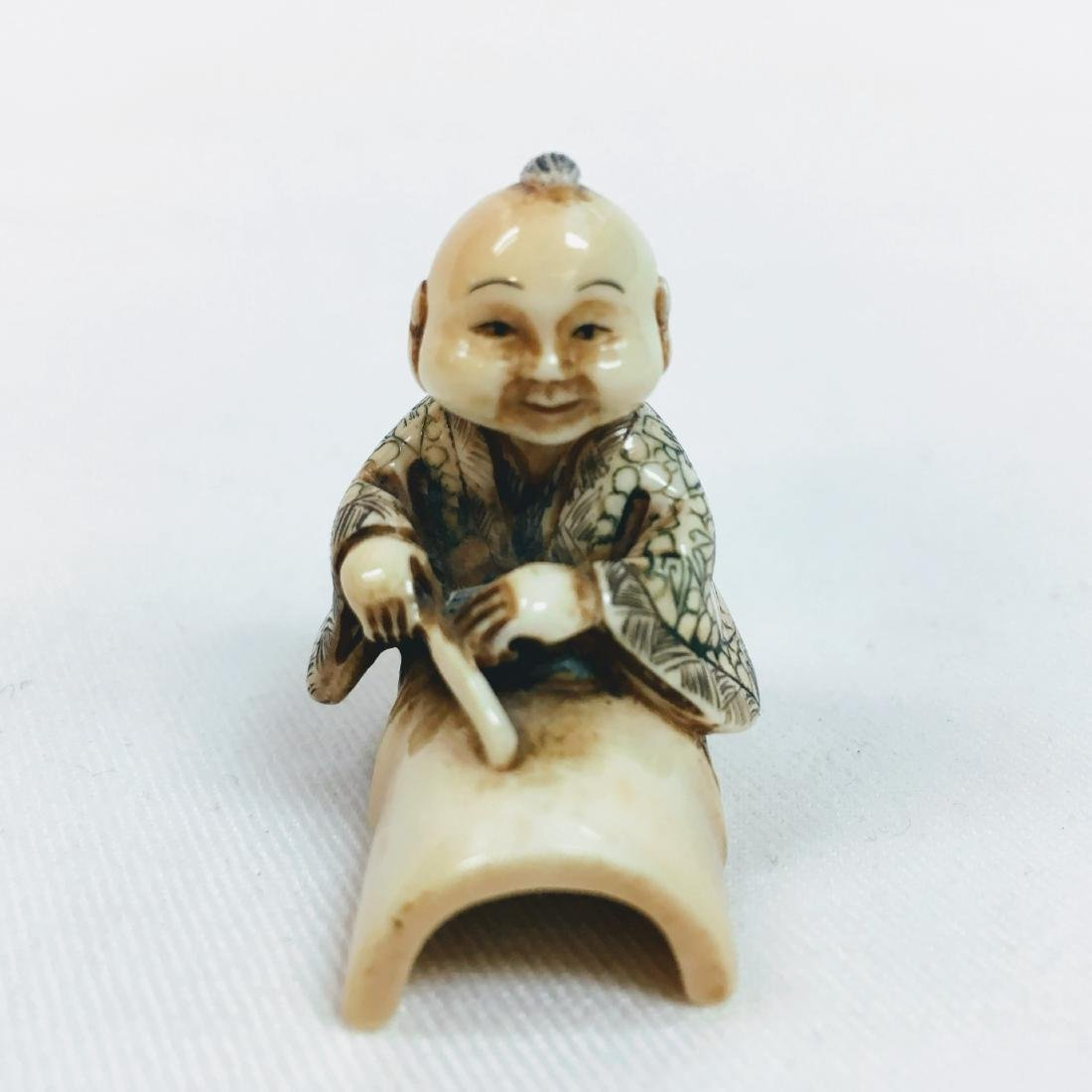 19th Century Netsuke man on and under trunk figure