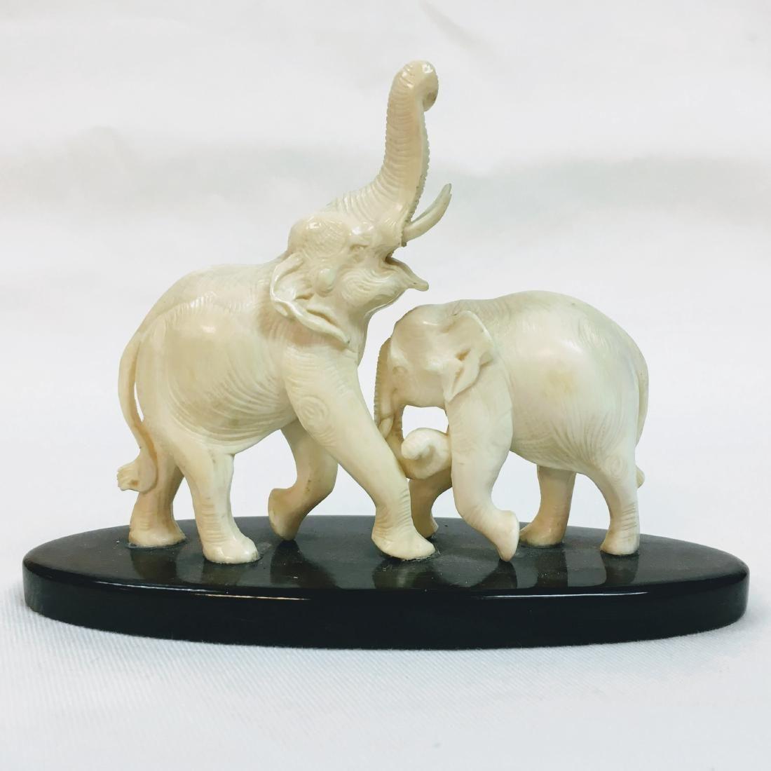 Handcarved two Elephant figure on base
