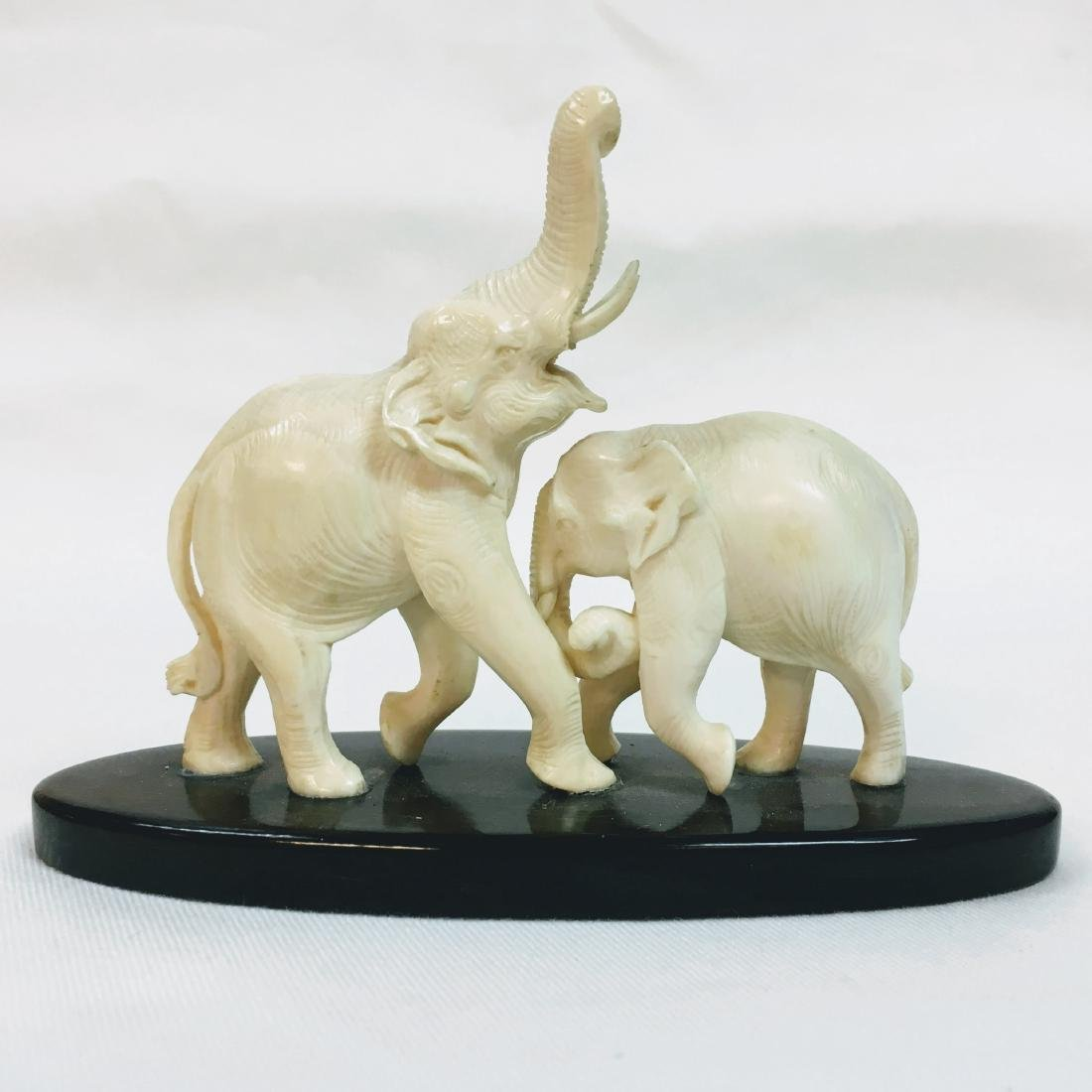 Handcarved two Elephant figure on base