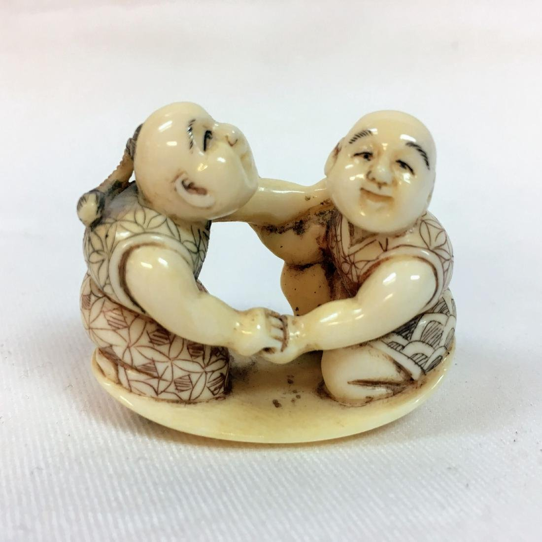 19th Century netsuke men wrestling
