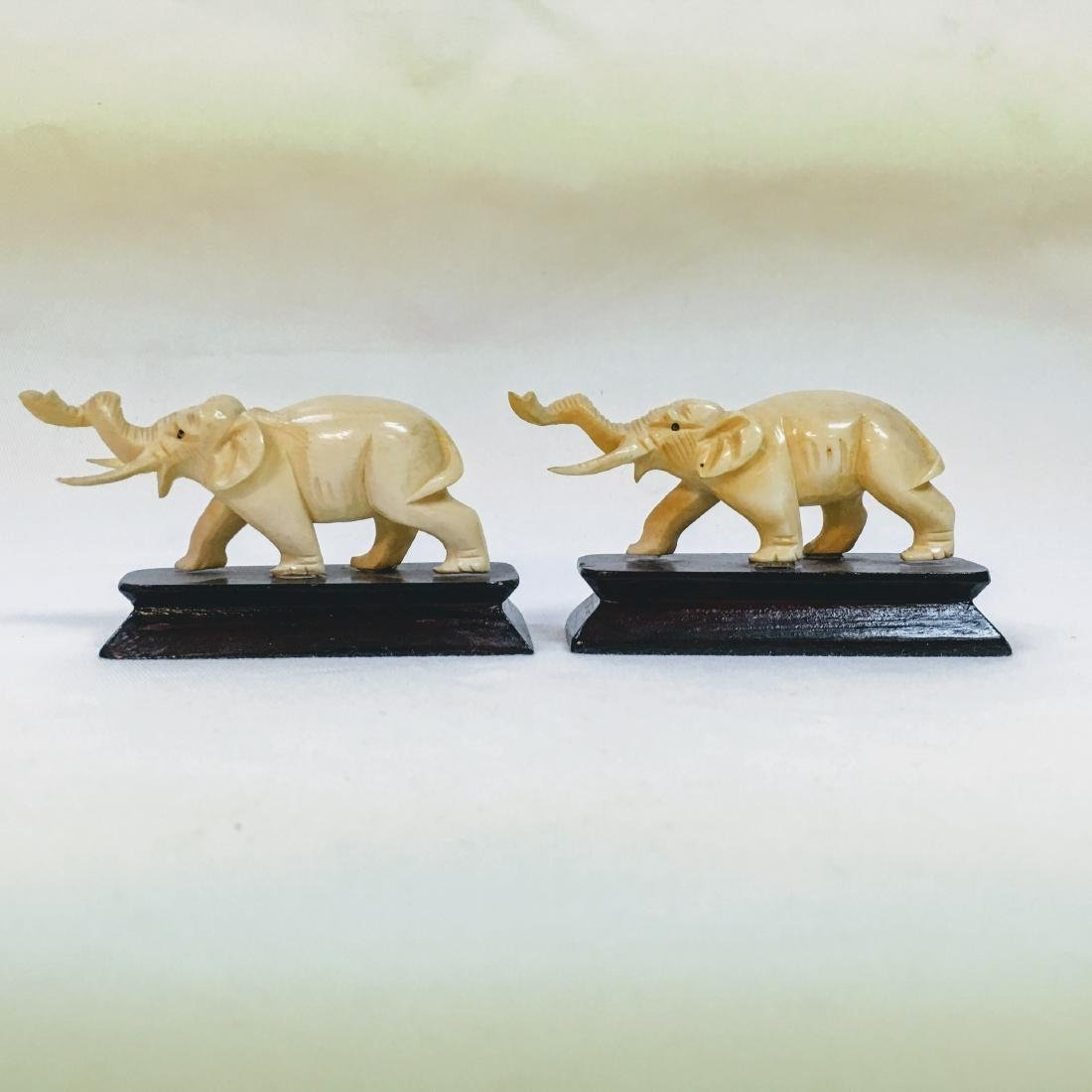 Vintage pair of Hand carved elephants on bases