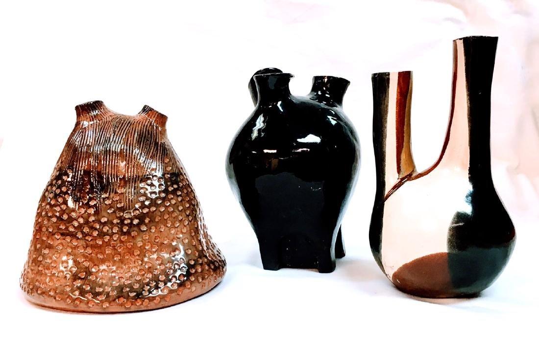 Set of three ceramic mid century vases, one is signed