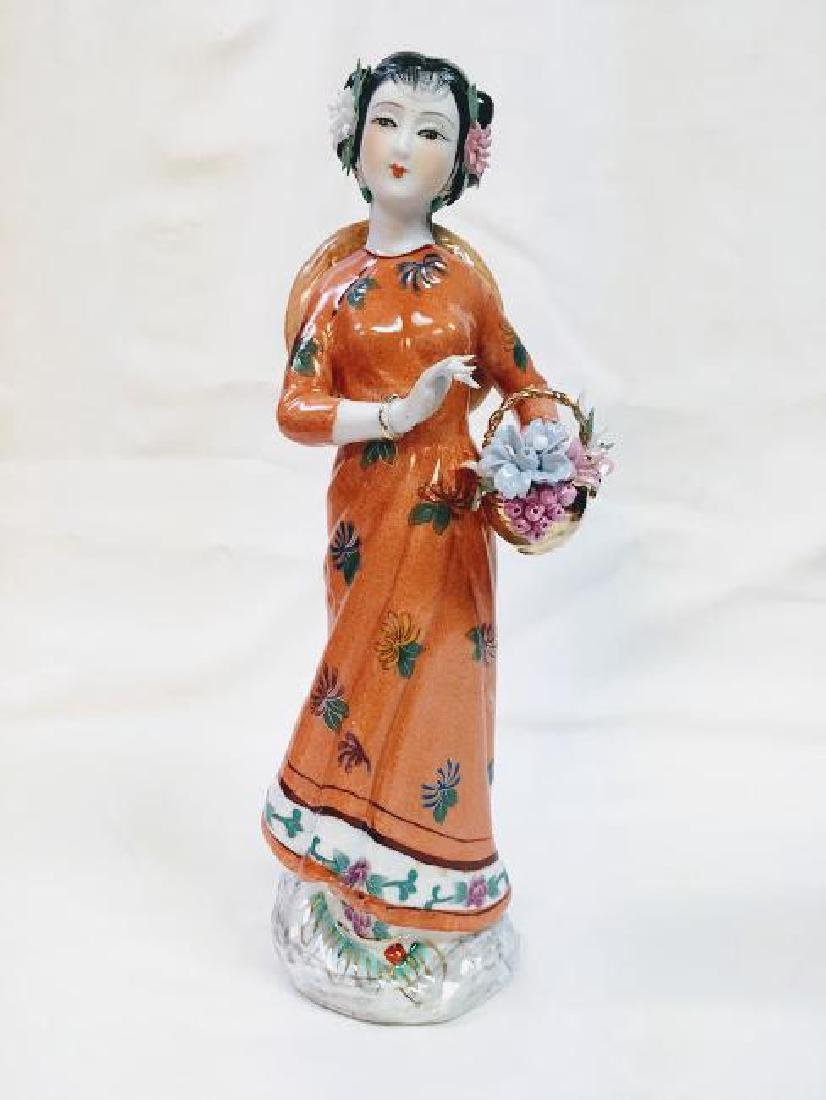Vintage porcelain Chinese geisha with flowers figurine