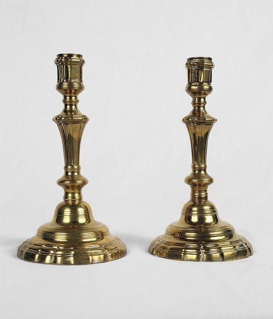 A Pair of Brass Plated Candlesticks