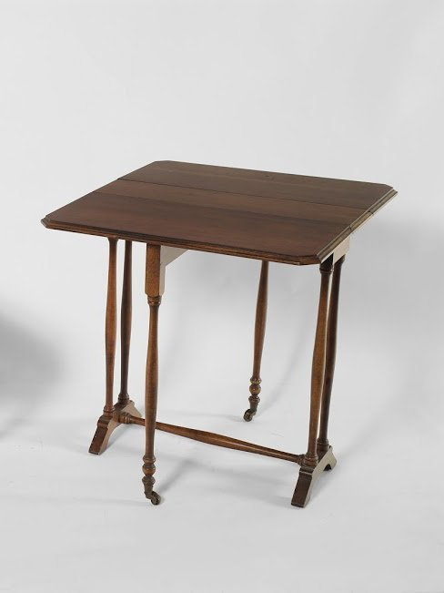 A Drop Leaf Brandt Walnut Side Table