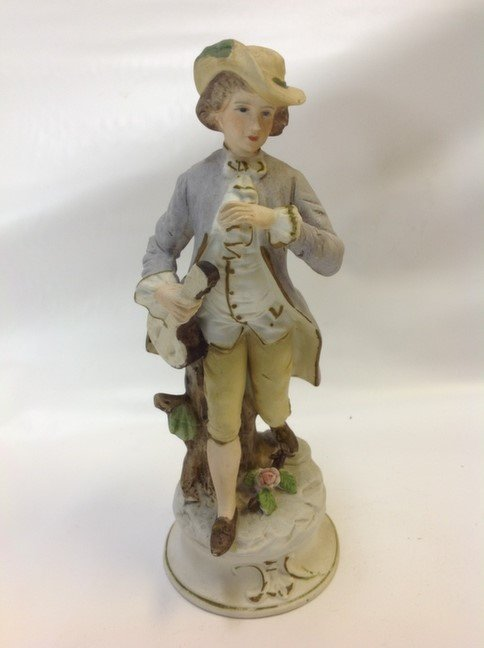 Capodimonte young man with musical instrument