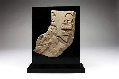 An Egyptian Limestone Relief Fragment