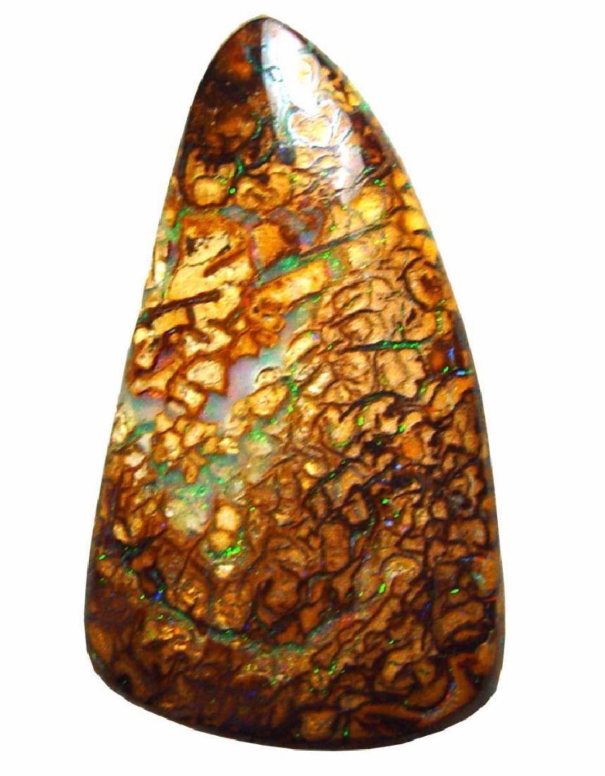 Boulder opal undrilled, translucent blue veins, 35