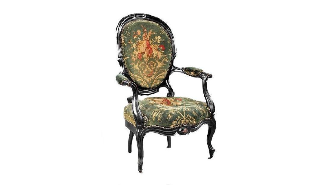 American Rococo Carved and Ebonized Armchair