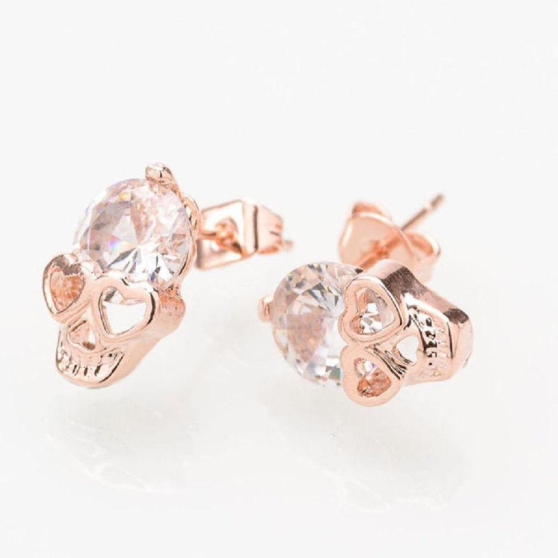Rose Gold Tone Crystal Diamond Skull Pierced Studs