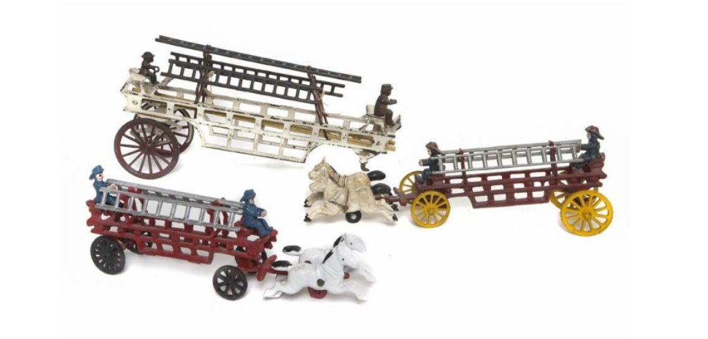 Three Cast Iron Fire trucks, two with horses. Len