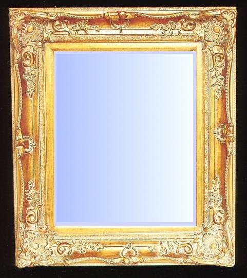 Heavily Ornate mirror with gold gilt swept frame