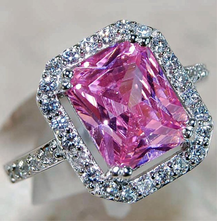 A 4 ct Pink Sapphire & White Topaz Ring