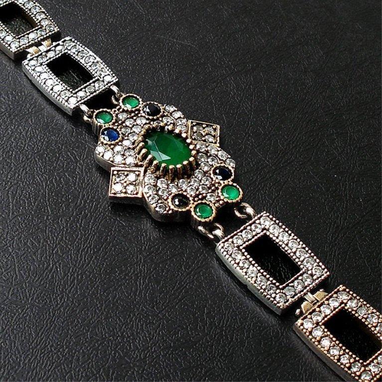 An Emerald, Topaz,  & Sapphire Bracelet