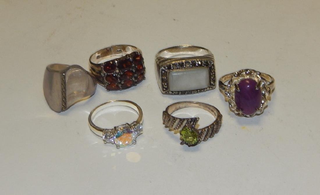 SIX STERLING SILVER RINGS