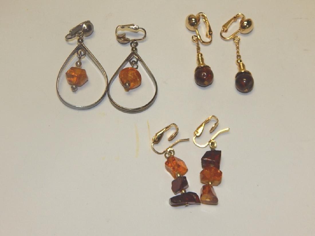 THREE PAIRS OF AMBER EARRINGS
