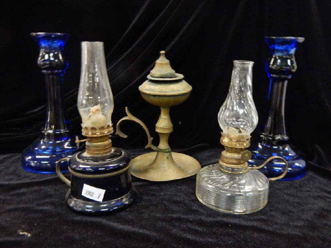 THREE OIL LAMPS WITH CANDLESTICKS