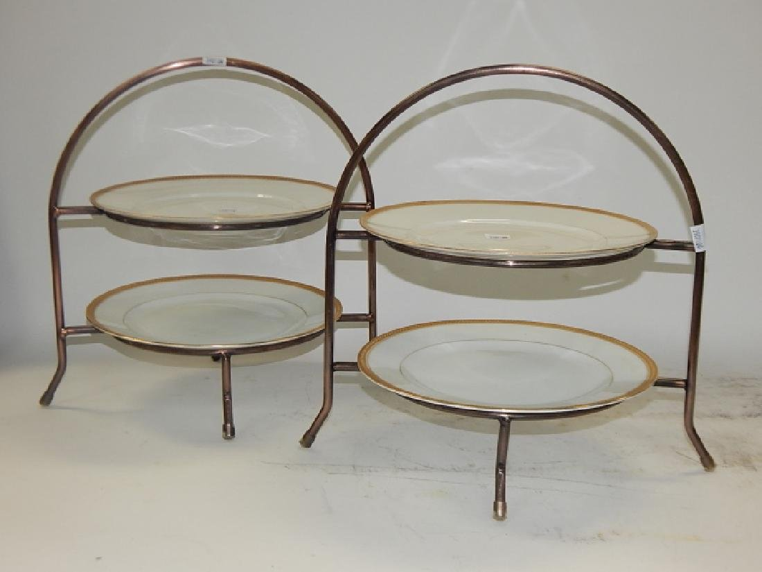 FOUR LIMOGES PLATES WITH METAL STANDS
